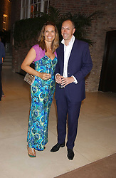 DYLAN JONES and his wife SARAH at a party to celebrate the publication of iPod, Therefore I am by Dylan Jones held at Asprey, 169 New Bond Street, London W1 on 14th July 2005.<br /><br />NON EXCLUSIVE - WORLD RIGHTS