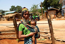 A Padaung woman with brass rings around her neck carries her child in Panpet Village, Demoso Township, Kayah State, Myanmar, April 11, 2016. The brass rings are first applied when the Padaung girls are about eight years old and as the girl grows older, longer coils are added up to 24 or 25 rings. EXPA Pictures © 2016, PhotoCredit: EXPA/ Photoshot/ U Aung<br /> <br /> *****ATTENTION - for AUT, SLO, CRO, SRB, BIH, MAZ, SUI only*****