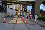 New Orleans, LA, USA -- May 24, 2019.  A photo of tourists walking by construction work on train tracks in the Central Business District of  New Orleans, LA.