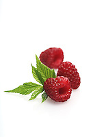 Raspberries on white background - studio shot