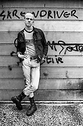 Neville in front of garage door, High Wycombe, 1980s.
