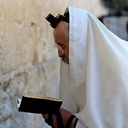 Pious Jewish man praying at the Westrn Wall (Kotel), holiest site in Judiasm, Jerusalem, Israel.