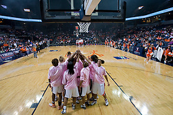 "The Virginia Cavaliers wore specially made pink warm up shirts for ""Think Pink"" night -- to raise awareness of cancer prevention.  The Virginia Cavaliers faced NC State Wolfpack women's basketball team at the John Paul Jones Arena in Charlottesville, VA on February 1, 2008."