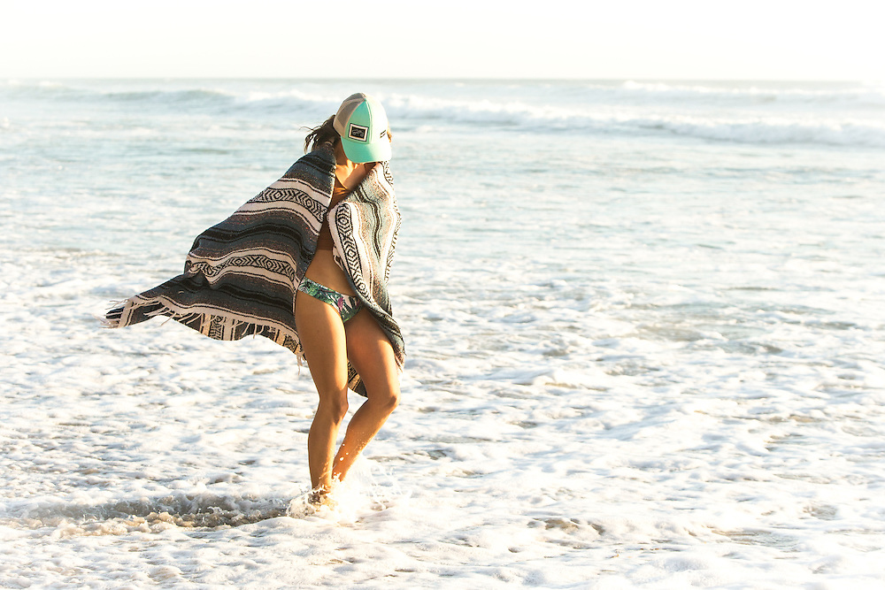 Girl at the beach wrapped in a Mexican blanket in San Diego, CA.
