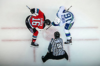 KELOWNA, BC - OCTOBER 16:  Linesman Cody Wanner drops the puck between Michael Farren #16 of the Kelowna Rockets and Matthew Culling #16 of the Swift Current Broncos at Prospera Place on October 16, 2019 in Kelowna, Canada. (Photo by Marissa Baecker/Shoot the Breeze)