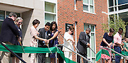 President McDavis and the families and honories cut the ribbion marking the grand opening of the new residential halls on south green. The new complex includes Luchs Hall, Tanaka Hall, Sowle Hall and Carr Hall.