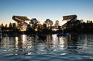 A sunset view of Husky Stadium from Union Bay during an NCAA football game between the University of Washington Huskies against Boise State Broncos at Husky Stadium on August 31, 2013 in Seattle, WA.  (AP Photo/Tom Hauck)