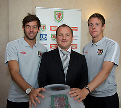 CARDIFF, WALES - Tuesday, August 31, 2010: Wales' Joe Ledley (L) and Chris Gunter (R) prepare for the draw of the Welsh Cup with FAW Head of Competitions Andrew Howard at the Vale of Glamorgan Hote;. (Pic by David Rawcliffe/Propaganda)