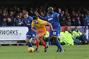 Dannie Bulman of AFC Wimbledon, Bayo Akinfenwa of AFC Wimbledon and Luke O'Nein of Wycombe Wanderers battle during the Sky Bet League 2 match between AFC Wimbledon and Wycombe Wanderers at the Cherry Red Records Stadium, Kingston, England on 21 November 2015. Photo by Stuart Butcher.
