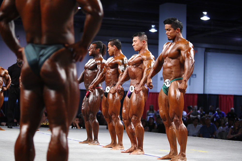 On stage at the pre-judging for the 2009 Olympia 202 competition in Las Vegas..Stan McQuay, Daryl Gee, Kris Dim, Clarence Devis