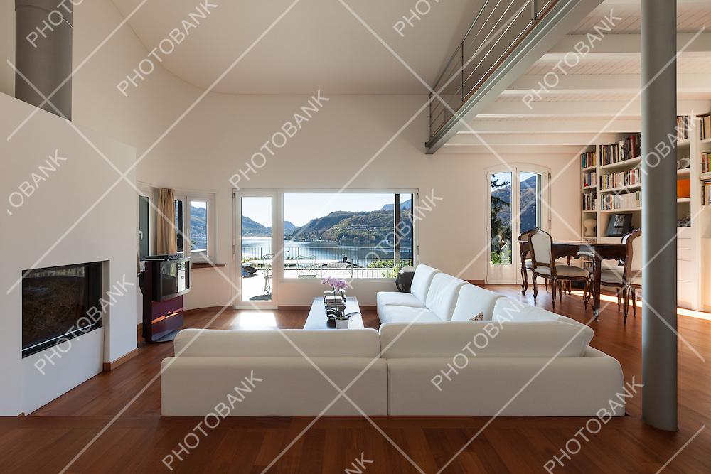 Interiors, comfortable living room of a loft, white divans