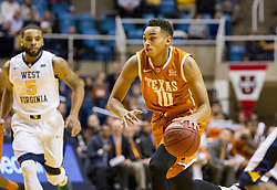 Jan 20, 2016; Morgantown, WV, USA; Texas Longhorns guard Eric Davis Jr. (10) drives to the basket during the first half against the West Virginia Mountaineers at the WVU Coliseum. Mandatory Credit: Ben Queen-USA TODAY Sports