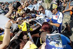 16.07.2010, Sachsenring, Hohenstein-Ernstthal, GER, MotoGP, Grand Prix von Deutschland, im Bild Valentino Rossi - Fiat Yamaha team wird von den Zuschauern und Fans bestürmt, das Interesse an dem Italiener ist riesengross, EXPA Pictures © 2010, PhotoCredit: EXPA/ InsideFoto/ Semedia, ATTENTION FOR AUSTRIA AND SLOVENIA USE ONLY! / SPORTIDA PHOTO AGENCY