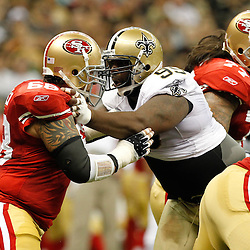 August 12, 2011; New Orleans, LA, USA; New Orleans Saints defensive tackle Aubrayo Franklin (99) rushes against San Francisco 49ers center Adam Snyder (68) during the first half of a preseason game at the Louisiana Superdome. Mandatory Credit: Derick E. Hingle