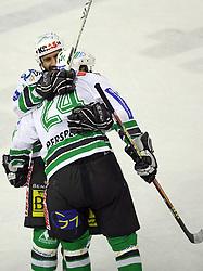 Raffaele Intranuovo and Tomaz Vnuk of ZM Olimpija at ice hockey matchZM Olimpija vs Liwest Linz in second round of semi-final of Ebel League (Erste Bank Eishockey Liga),  on February 28, 2008 in Arena Tivoli, Ljubljana, Slovenia. Win of ZM Olimpija 3:2. (Photo by Vid Ponikvar / Sportal Images)