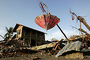 January 6, 2004 Banda Aceh, Indonesia--  An umbrella sits in a precarious perch among the remains of homes after the Dec. 26 tsunami wave which killed tens of thousands of people.