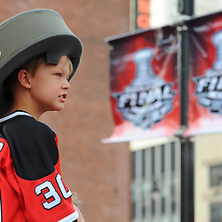 May 30, 2012: A young fan takes in festivities prior to game 1 of the NHL Stanley Cup Final between the New Jersey Devils and the Los Angeles Kings at the Prudential Center in Newark, N.J.
