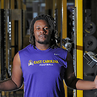 East Carolina University football player Terrell Stanley poses for a photo in the weight room on the campus of East Carolina University in Greenville, N.C., Monday, November 10, 2014. Former South Brunswick football player Terrell Stanley, who was severely injured in a car accident in the February is recovering and plans to return to the East Carolina University football team next fall. StarNews Photo by Mike Spencer