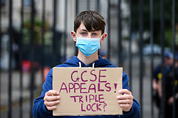 © Licensed to London News Pictures. 21/08/2020. LONDON, UK.  GCSE and BTec student Tommy Walsh (aged 16) joins students protesting outside Downing Street calling for the resignation of Gavin Williamson, Secretary for Education, following this year's exam results chaos.  After a successful campaign for A-Level and GCSE students to have grades based on teacher assessments rather than on a computer algorithm, BTec students will have to wait while exam board Pearson regrades their results.  (Parental permission obtained)  Photo credit: Stephen Chung/LNP