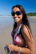 Brazilian girl on Praia Grande at Grajagan Resort, Ilha do Mel, Brazil