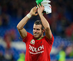 CARDIFF, WALES - Tuesday, October 13, 2015: Wales' Gareth Bale celebrates qualifying for the finals after the 2-0 victory over Andorra during the UEFA Euro 2016 qualifying Group B match at the Cardiff City Stadium. (Pic by Barry Coombs/Propaganda)