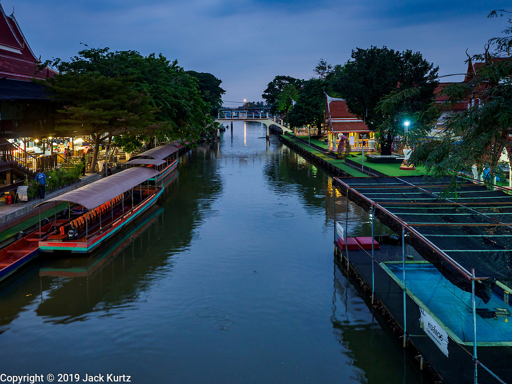 05 JANUARY 2019 - MINBURI, BANGKOK, THAILAND:  along Khlong Saen Saeb, at the Kwan Riam Floating Market in Minburi, east of downtown Bangkok. People gather on both sides of the khlong (canal) between Wat Bamphen Nuea and Wat Bamphen Tai, monks in boats go past them as people present the monks with food, flowers, and other offerings.          PHOTO BY JACK KURTZ