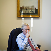 On his first day as a United States Senator, Angus King (I-ME) sits in his temporary office, contemplating his new roles serving on four committees, one of which is the budget committee.  Earlier in the day, King was sworn in as a Senator.  For The Portland (Maine) Press-Herald.