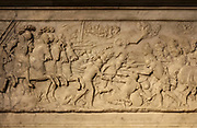 Battle of Marignano in 1515, relief on the base of the funerary monument of Francois I, 1494-1547, and Claude of France, 1499-1524, commissioned by Henri II and made by Pierre Bontemps in 1550, in the Basilique Saint-Denis, Paris, France. This monument originally came from the Abbaye des Hautes-Bruyires in Yvelines. The basilica is a large medieval 12th century Gothic abbey church and burial site of French kings from 10th - 18th centuries. Picture by Manuel Cohen