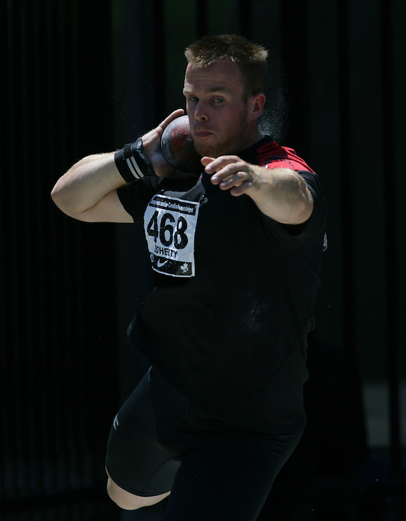 (Toronto, Ontario---27/06/09)   Matthew Doherty competing in the shot put final at the 2009 Canadian National Track and field Championships. Photograph copyright Sean Burges / Mundo Sport Images, 2009. www.mundosportimages.com / www.msievents.