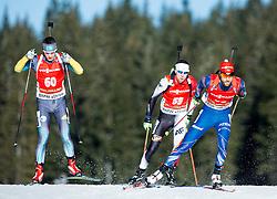 SAVITSKIY Yan (KAZ), GUZIK Grzegorz (POL) and KRUPCIK Tomas (CZE) competes during Men 12,5 km Pursuit at day 3 of IBU Biathlon World Cup 2014/2015 Pokljuka, on December 20, 2014 in Rudno polje, Pokljuka, Slovenia. Photo by Vid Ponikvar / Sportida