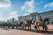 Passing Buckingham Palace. On the 100th anniversary of women getting the vote, Kings troop is led by female officers and has a high proportion of female troopers - The King's Troop Royal Horse Artillery, ride their horses and gun carriages past Buckingham Palace to Green Park to stage a 41 Gun Royal Salute to mark the 66th Anniversary of the Accession of Her Majesty The Queen.