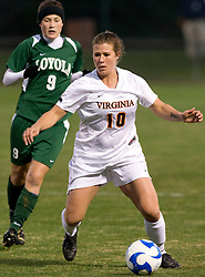 Virginia forward/midfielder Kelly Quinn (10) dribbles around Loyola midfielder Lea Day (9).  The Virginia Cavaliers defeated the Loyola (MD) Greyhounds 4-1 in the first round of the NCAA Women's Soccer tournament held at Klockner Stadium in Charlottesville, VA on November 16, 2007.