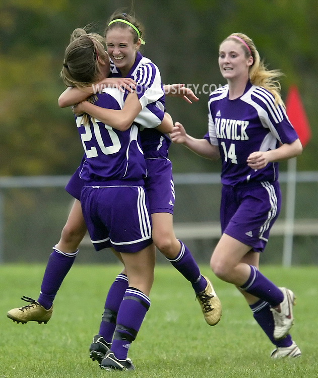 Warwick's Jenna Maisto, center, celebrates with Warwick's Molly Warren (20) as teammate Meagan Brady (14) looks on after Maisto scored the only goal in a 1-0 victory over Washingtonville in Washingtonville on Tuesday, Sept. 22, 2009.