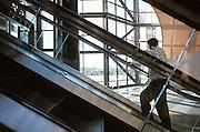 man ascending in escalator