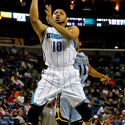 April 15, 2012; New Orleans, LA, USA; New Orleans Hornets shooting guard Eric Gordon (10) shoots over Memphis Grizzlies point guard Mike Conley (11) during the second quarter of a game at the New Orleans Arena.   Mandatory Credit: Derick E. Hingle-US PRESSWIRE