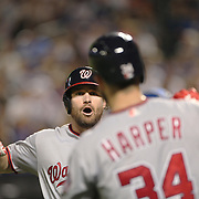 NEW YORK, NEW YORK - July 07: Daniel Murphy #20 of the Washington Nationals celebrates with Bryce Harper #34 of the Washington Nationals after hitting a home run during the Washington Nationals Vs New York Mets regular season MLB game at Citi Field on July 07, 2016 in New York City. (Photo by Tim Clayton/Corbis via Getty Images)