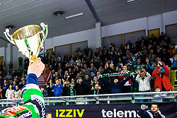 Ales Music of Olimpija with trophy at medal ceremony during ice hockey game between HDD Telemach Olimpija and Team Jesenice in 2nd leg of Finals of Slovenian National Championship 2014, on April 3, 2014 in Hala Tivoli, Ljubljana, Slovenia. Photo by Matic Klansek Velej / Sportida
