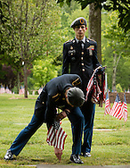 Goshen, New York - Minisink Valley High School Army JROTC cadets place American flags by a veterans' graves at the Orange County Veteran's Cemetery in preparation for Memorial Day on May 24, 2016.