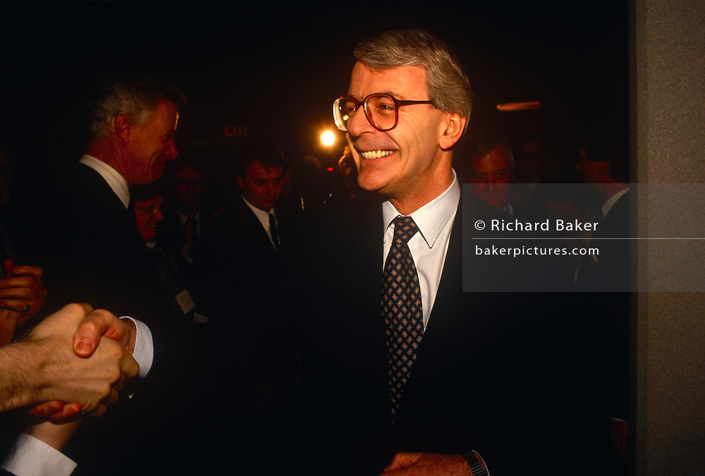 British Prime Minister, John Major shakes hands with supporters during a Conservative party election rally on 14th March 1992, in Brighton, England. Major went on to win the election weeks later and was the fourth consecutive victory for the Conservative Party although it was its last outright win until 2015 after Labour's 1997 win for Tony Blair.
