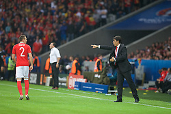 LILLE, FRANCE - Friday, July 1, 2016: Wales manager Chris Coleman issues instructions to Chris Gunter during the UEFA Euro 2016 Championship Quarter-Final match  against Belgium at the Stade Pierre Mauroy. (Pic by Paul Greenwood/Propaganda)