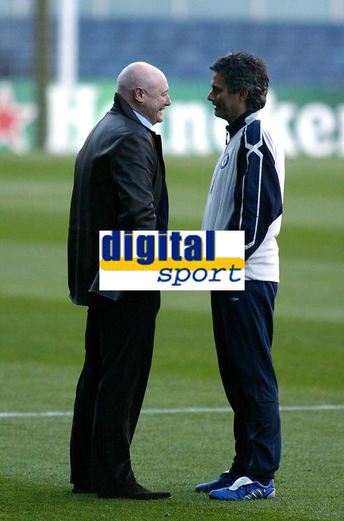 Photo: Chris Ratcliffe.<br />Chelsea Training Session. UEFA Champions League. 06/03/2006. <br />Chelsea's Jose Mourinho (rt) talks to Peter Kenyon.
