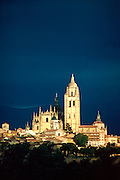 SPAIN, CASTILE and LEON, SEGOVIA the 16th century Gothic Cathedral and city skyline with the Guadarrama Mountains beyond