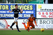 Dundee defender Cammy Kerr (#2) fouls Dundee United midfielder Scott?Fraser (#10) during the Betfred Scottish Cup group stage match between Dundee and Dundee United at Dens Park, Dundee, Scotland on 29 July 2017. Photo by Craig Doyle.