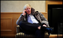 Boris Johnson during his phone interview with The Times while out and about in Henden, London,  United Kingdom. Thursday, 28th November 2013. The Boy's Club House offers mentoring, activities, careers advice in the Jewish Community. Picture by Andrew Parsons / i-Images