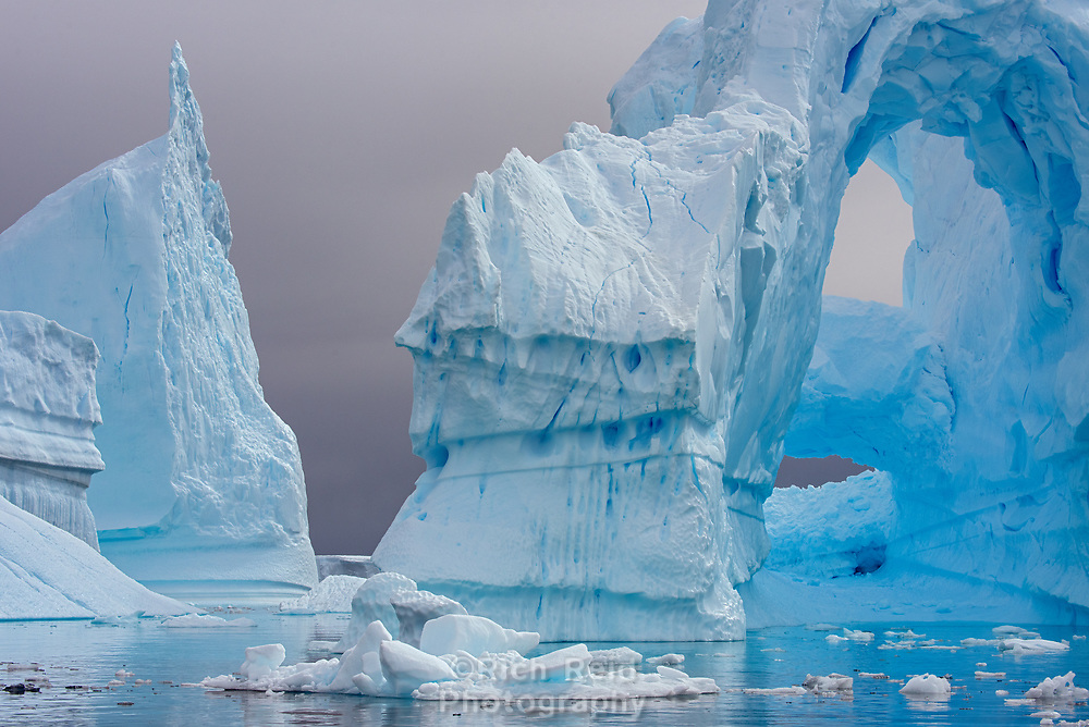 """Incredible ice formations in the """"iceberg graveyard"""" at Port Charcot in the Wilhelm Archipelago of Antarctica."""