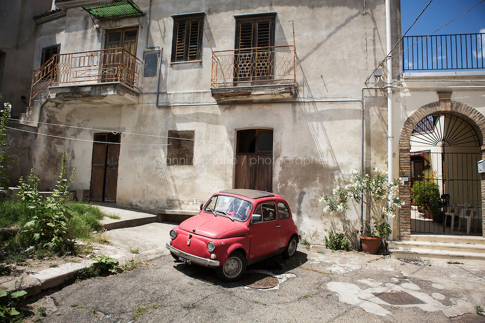 GRASSANO, ITALY - 24 JULY 2014: A Fiat 500 car is parked in a small square of Grassano, the ancestral home town of Mayor of New York Bill de Blasio in Italy, on July 24th 2014.<br /> <br /> New York City Mayor Bill de Blasio arrived in Italy with his family Sunday morning for an 8-day summer vacation that includes meetings with government officials and sightseeing in his ancestral homeland.