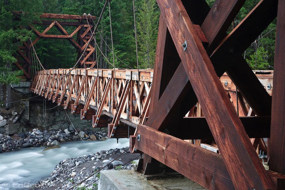Nisqually River wooden suspension bridge at Longmire village in Mount Rainier National Park, WA USA