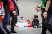 UNITED KINGDOM, London: 25 October 2015. <br /> Comic Con Feature.<br /> Cosplay fans sit on the floor exhausted as people walk past on the final day of the MCM London Comic Con.<br /> Photo: Rick Findler / Story Picture Agency