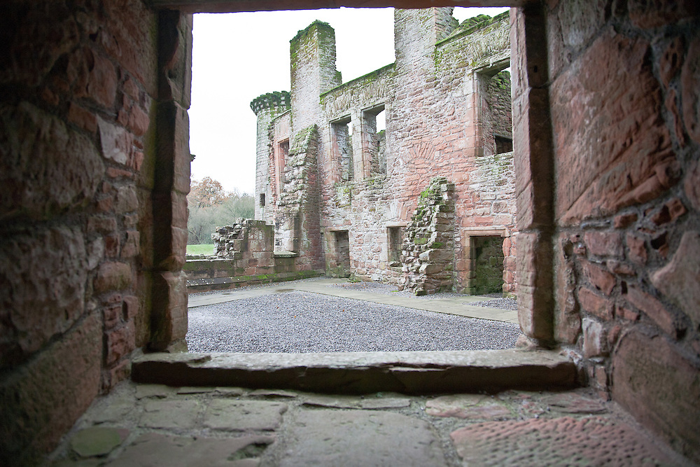 Looking through a window on the inside of Caelaverock Castle.<br /> Caerlaverock Castle is a moated triangular castle, built in the 13th century, in the Caerlaverock National Nature Reserve area at the Solway Firth, south of Dumfries in the southwest of Scotland. In the Middle Ages it was owned by the Maxwell family. Today, the castle is in the care of Historic Scotland and is a tourist attraction and popular wedding venue. It is protected as a scheduled monument, and as a category A listed building.
