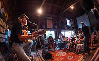 "Drew Seneca starts off a session during ""Duanestock"" held in Duane Johnson's 133 years old barn on Saturday evening.  (Karen Bobotas/for the Laconia Daily Sun)"